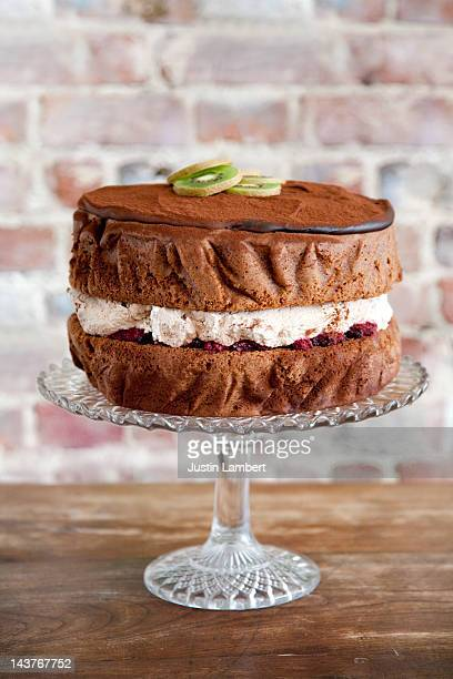 chocolate cake with raspberry and cream filling - cakestand stock pictures, royalty-free photos & images