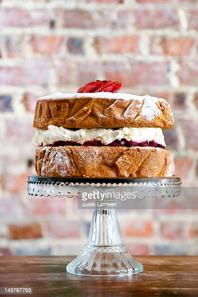 traditional victoria sponge cake on glass stand - sponge cake stock pictures, royalty-free photos & images