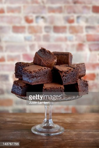 Pile Of Chocolate Brownies On Cake Stand Stock Photo