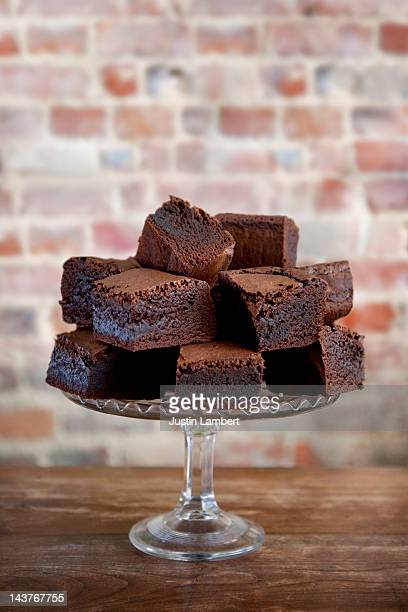 pile of chocolate brownies on cake stand - brownie stock pictures, royalty-free photos & images