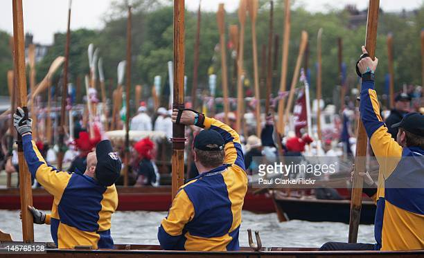 The manpowered section salute the Queen by raising their oars blades pointing towards the Spirit of Chartwell LONDON JUNE 3