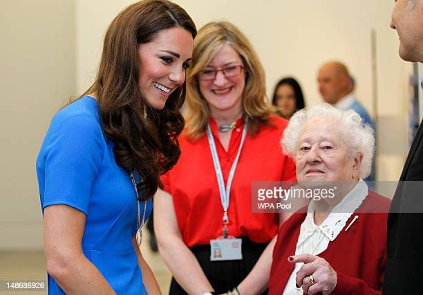 Catherine Duchess of Cambridge chats to 100yeraold portrait sitter Diana Gould during her visit to the 'Road To 2012 Aiming High' exhibition at the...