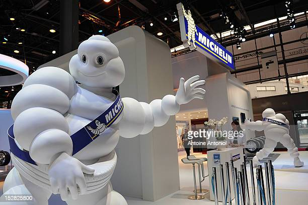 A statue of the Michelin 'Michelin Man' sits on display at the Paris Auto Show on September 27 2012 in Paris France The Paris Motor Show runs...