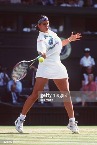 CONCHITA MARTINEZ OF SPAIN IN ACTION AGAINST LORI MCNEIL OF THE USA IN THE 1994 WIMBLEDON TENNIS CHAMPIONSHIPS MARTINEZ BEAT MCNEIL 36 62 108