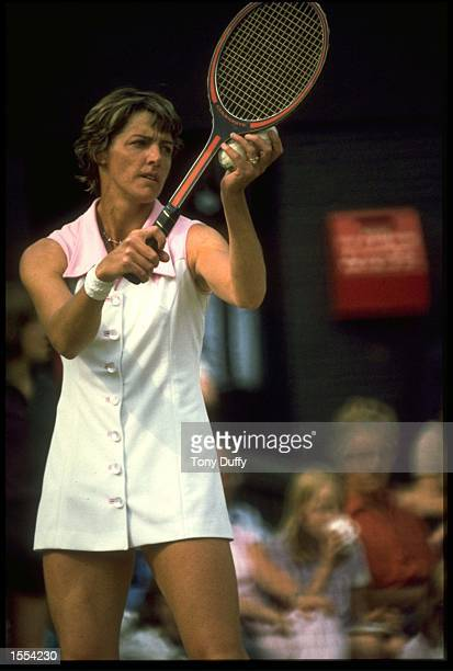 MARGARET COURT OF AUSTRALIA PREPARES TO MAKE A SERVE DURING A MATCH AT THE WIMBLEDON TENNIS CHAMPIONSHIPS