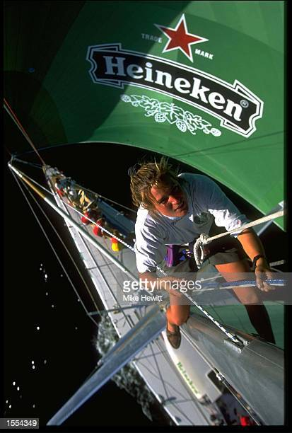 MERRIT CAREY FROM THE HEINEKEN YACHT CLIMBS THE MAST TO CARRY OUT CHECKS AS THE BOAT DEPARTS FORT LAUDERDALE USA DURING THE WHITBREAD ROUND THE WORLD...