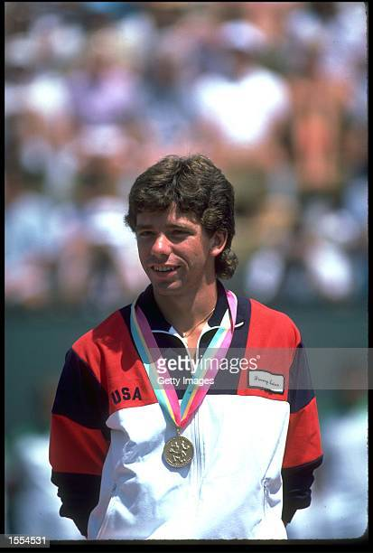 JIMMY ARIAS OF THE UNITED STATES RECEIVES THE BRONZE MEDAL IN THE MENS SINGLES TENNIS EVENT AT THE 1984 LOS ANGELES OLYMPICS ARIAS CRASHED OUT OF THE...