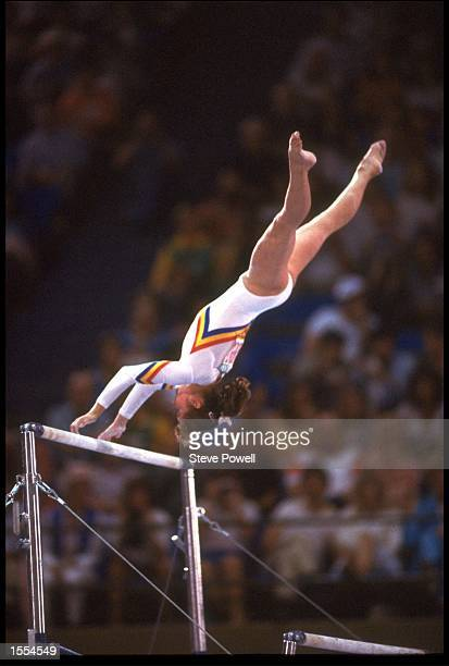 ECATERINA SZABO OF ROMANIA IN ACTION DURING HER ROUTINE ON THE ASSYMETRICAL BARS AT THE 1984 LOS ANGELES OLYMPICS