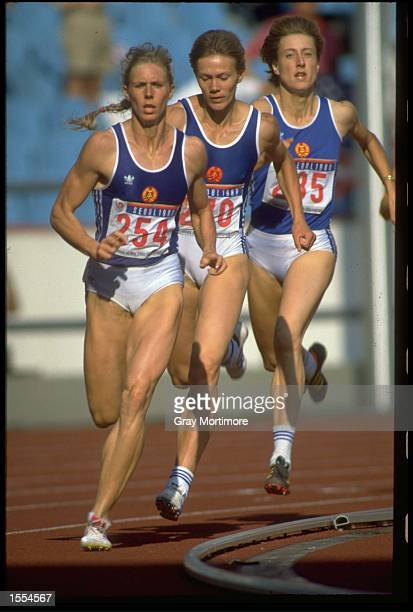 ANKE BEHMER OF EAST GERMANY LEADS FROM TEAM MATES SABINE JOHN AND INES SCHULZ DURING THE 800 METRES DISCIPLINE IN THE HEPTATHLON COMPETITION AT THE...