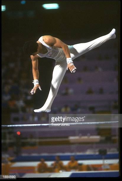 SHINJI MORISUE OF JAPAN IN MID FLIGHT DURING HIS ROUTINE ON THE HIGH BAR AT THE 1984 LOS ANGELES OLYMPICS MORISUE WON THE GOLD IN THIS EVENT WITH A...