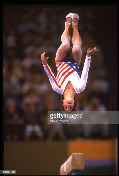 MARY LOU RETTON OF THE UNITED STATES PERFORMS A FLIP ON THE BALANCE BEAM DURING HER ROUTINE AT THE 1984 LOS ANGELES OLYMPICS RETTON WON THE OVERALL...