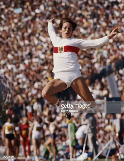 HEIDE ROSENDAHL OF WEST GERMANY CAUGHT IN MID FLIGHT DURING THE LONG JUMP EVENT AT THE 1972 MUNICH OLYMPICS ROSENDAHL WON THE GOLD MEDAL WITH A JUMP...