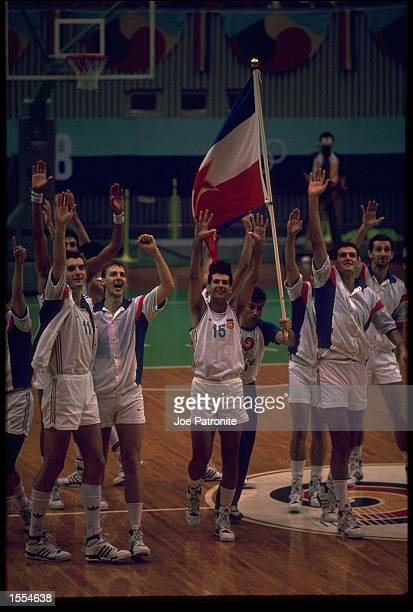 THE YUGOSLAVIA BASKETBALL TEAM CELEBRATE THEIR VICTORY OVER THE SOVIET UNION DURING THE OPENING ROUND OF THE 1988 SEOUL OLYMPICS BASKETBALL...
