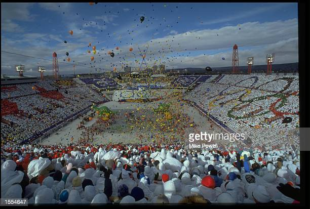 THE COLOURFUL CROWD LOOKS ON AS HUNDREDS OF BALLOONS ARE RELEASED DURING THE OPENING CEREMONY OF THE 1988 WINTER OLYMPICS IN CALGARY.