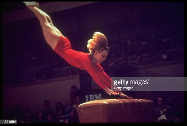 VERA CASLAVSKA OF CZECHOSLOVAKIA IN ACTION DURING THE SIDE HORSE VAULT COMPETITION AT THE 1968 SUMMER OLYMPICS HELD IN MEXICO CITY CASLAVSKA WON THE...