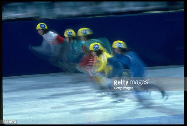 AN IMPRESSION SHOT OF THE START OF A WOMENS SHORT TRACK SKATING RACE TAKEN AT THE 1988 WINTER OLYMPICS HELD IN CALGARY