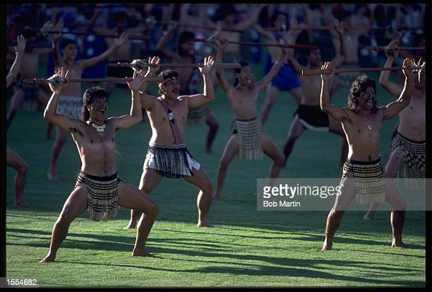 A GROUP OF MAORI DANCERS PERFORM TO WELCOME THE ATHLETES TO NEW ZEALAND DURING THE OPENING CEREMONY OF THE 1990 COMMONWEALTH GAMES HELD IN AUCKLAND