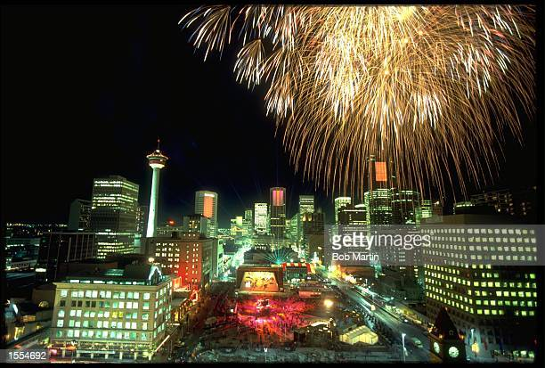 FIREWORKS EXPLODE ABOVE THE SKYLINE OF CALGARY DURING THE OPENING CEREMONY FOR THE 1988 WINTER OLYMPICS HELD IN CALGARY IN CANADA