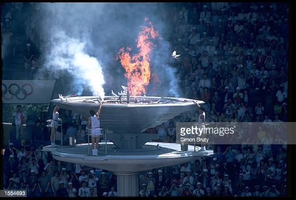 THE OLYMPIC FLAME IS LIT BY TORCH BEARERS DURING THE OPENING CEREMONY OF THE 1988 SUMMER OLYMPICS HELD IN SEOUL IN SOUTH KOREA