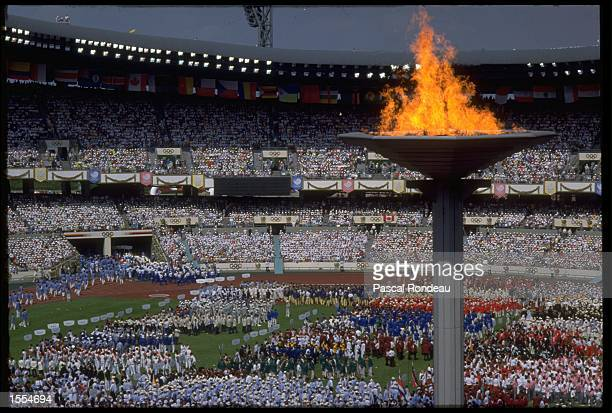 THE TEAMS ENTER THE STADIUM AND GATHER ON THE FIELD DURING THE OPENING CEREMONY OF THE 1988 SUMMER OLYMPICS HELD IN SEOUL IN SOUTH KOREA