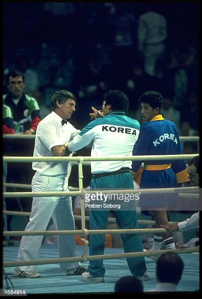 BOXING TRAINER LEE HEUNGSOO OF SOUTH KOREA CONFRONTS REFEREE KEITH WALKER AFTER THE BYUN JONGIL OF SOUTH KOREA LOST HIS FIGHT AGAINST ALEXANDER...