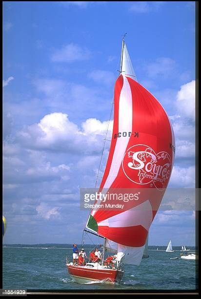 THE BRILLIANT RED COLOURING OF CLASS 1 YACHT RED SOUCERON STANDS OUT AGAINST THE BLUE SKY TODAY AT COWES WEEK 1994