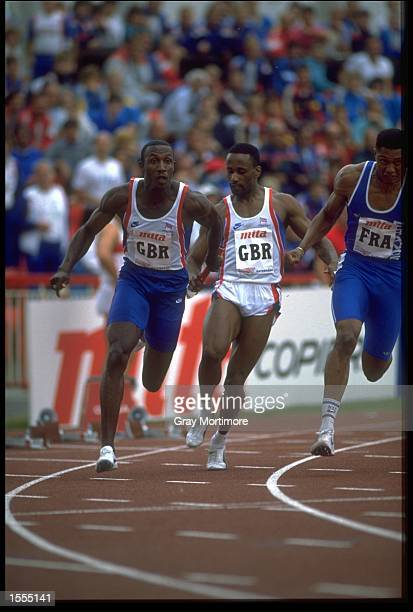 LINFORD CHRISTIE OF GREAT BRITAIN RECEIVES THE BATON FROM TEAM MATE MARCUS ADAM AND STARTS THE ANCHOR LEG IN THE 4 X 100 METRES RELAY IN THE EUROPEAN...