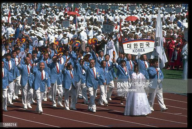 THE OLYMPIC SQUAD OF KOREA MARCH THROUGH THE STADIUM DURING THE OPENING CEREMONY OF THE 1988 SUMMER OLYMPICS HELD IN SEOUL IN SOUTH KOREA