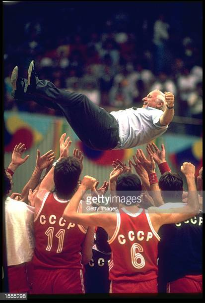 ALEXANDRE GOMELSKI THE COACH OF THE SOVIET UNION IS TOSSED INTO THE AIR BY HIS BASKETBALL TEAM AFTER THEY DEFEATED YUGOSLAVIA TO CLAIM THE GOLD MEDAL...