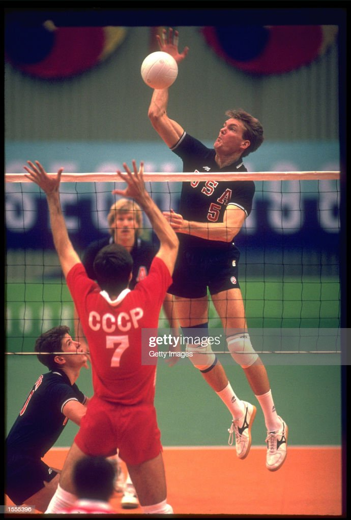 ROBERT PARTIE OF THE UNITED STATES LEAPS UP TO SPIKE THE BALL OVER RAIMONDS VILDE OF THE SOVIET UNION DURING THE FINAL OF THE MENS VOLLEYBALL TOURNAMENT AT THE 1988 SEOUL OLYMPICS. THE UNITED STATES WON THE MATCH 13-15, 15-10, 15-4 AND 15-8TO CLAIM THE GOLD.