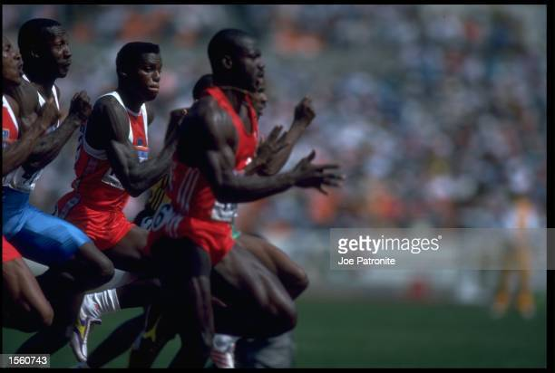 CARL LEWIS OF THE UNITED STATES AND LINFORD CHRISTIE OF GREAT BRITAIN ATTEMPT TO CATCH RACE LEADER BEN JOHNSON OF CANADA DURING THE 100 METRE SPRINT...