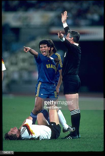 GEOVANI SILVA OF BRAZIL HAS A WORD WITH THE REFEREE AFTER AN INCIDENT INVOLVING FRANK MILL OF WEST GERMANY DURING THEIR SEMIFINAL MATCH AT THE 1988...