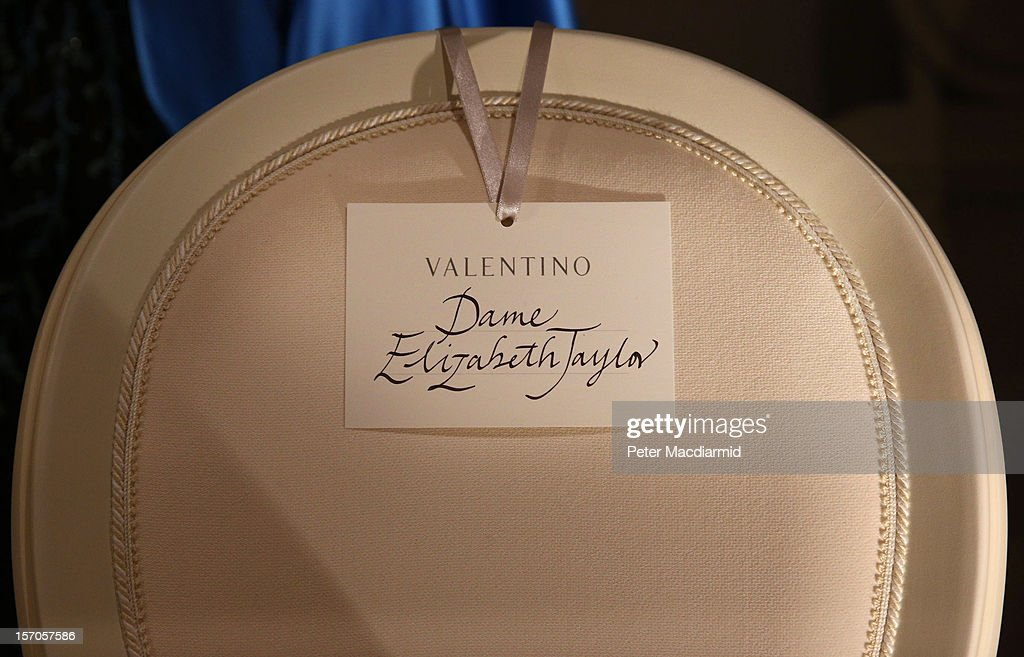 A chair with a name card of Dame Elizabeth Taylor is placed amongst the dresses in a catwalk display at the 'Valentino: Master of Couture' exhibition at Somerset House on November 28, 2012 in London, United Kingdom. Celebrating the life and work of the Italian master couturier, the show features over 130 hand crafted designs worn by Hollywood icons and Royalty. The exhibition runs from November 29, 2012 - March 3, 2013.