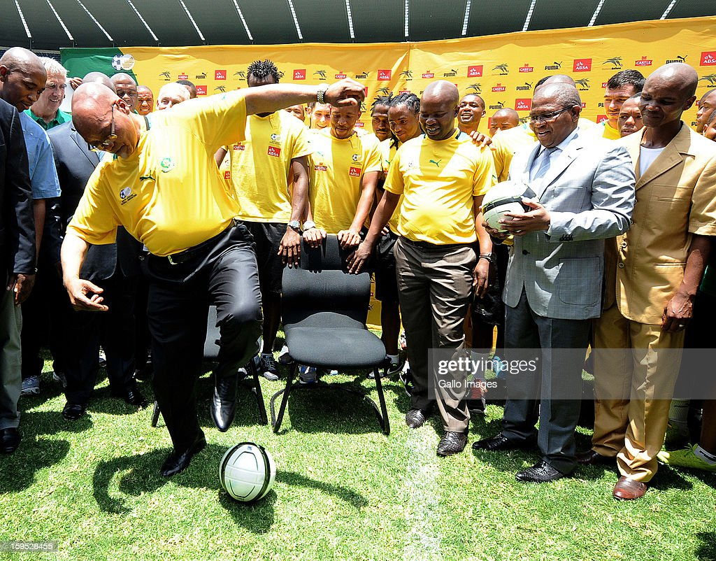 South Africa's President Jacob Zuma practices ball skills while visiting South Africa's national team at Orlando Stadium on January 15, 2013 in Soweto, South Africa. Bafana Bafana players are in training for the 2013 Africa Cup of Nations (AFCON) international soccer tournament, January 19 - February 10, 2013.