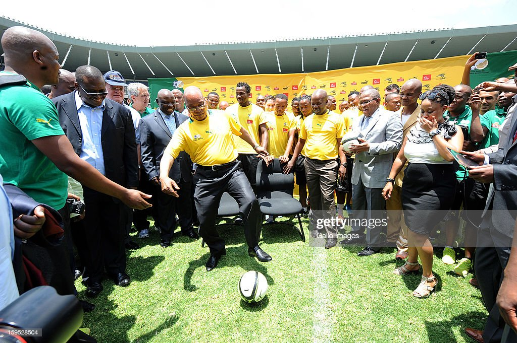 South Africa's President Jacob Zuma practices ball skills while visiting South Africa's national football team at Orlando Stadium on January 15, 2013 in Soweto, South Africa. Bafana Bafana players are in training for the 2013 Africa Cup of Nations (AFCON) international soccer tournament, January 19 - February 10, 2013.