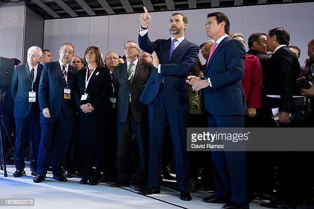 Prince Felipe of Spain and Minister of Industry Energy and Tourism Jose Manuel Soria visits the Mobile World Congress 2013 at the Fira Gran Via...