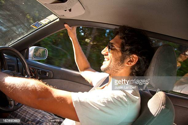 GUY ENJOYING THE DRIVE TO THE BEACH