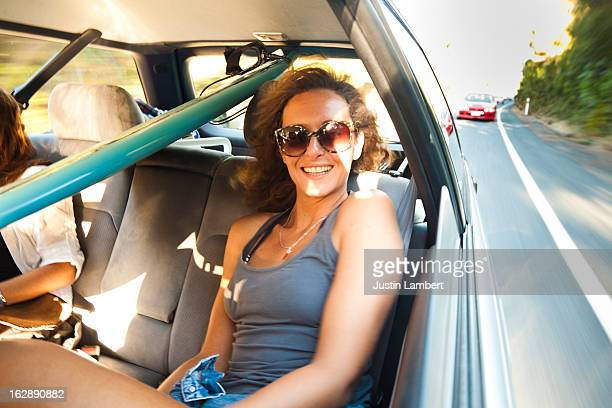 GIRL WITH OPEN WINDOW IN CAR