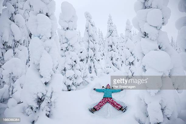 A PERFECT SNOW ANGEL IN A SNOWY FOREST