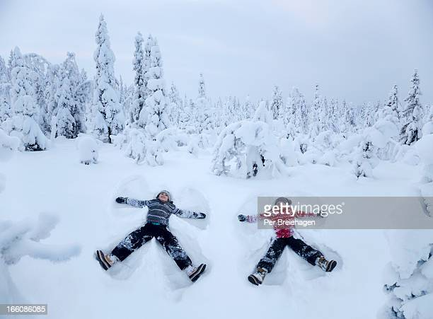 TWO SNOW ANGELS IN A SNOWY FOREST