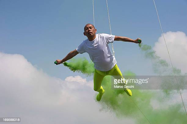 Chinese artist Li Wei performs in front of Saint's Mark as pst of the 55th International Art Exhibition on May 28 2013 in Venice Italy The 55th...