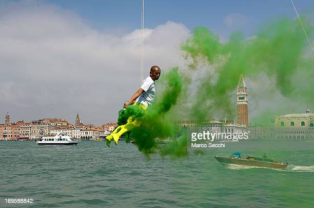 Chinese artist Li Wei performs in front of Saint's Mark as part of the 55th International Art Exhibition on May 28 2013 in Venice Italy The 55th...