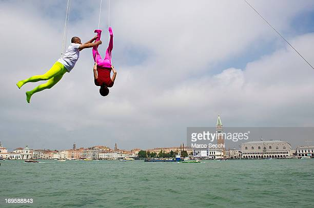 Chinese artist Li Wei and his assistant perform in front of Saint's Mark as part of the 55th International Art Exhibition on May 28 2013 in Venice...