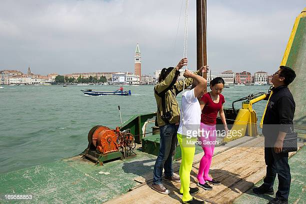 Chinese artist Li Wei gets ready before performing in front of Saint's Mark as part of the 55th International Art Exhibition on May 28 2013 in Venice...