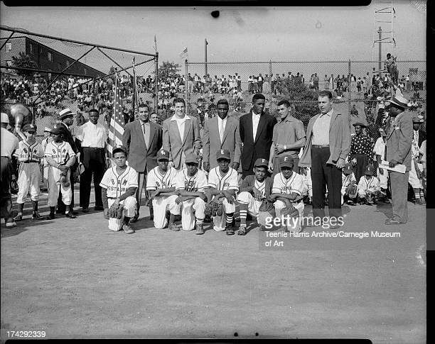 Douglas Jones Charles Evans Thomas Wallace Sterling Smith Joe Lewis Larry Hubbard back row Roy Campanella Gair Allie Jackie Robinson Joe Black Carlos...