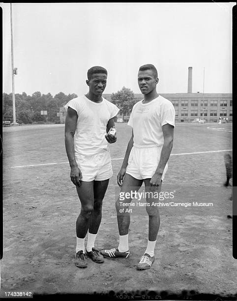 University of Pittsburgh track stars David Peays holding medal and Arnold 'Arnie' Sowell standing on Oliver Field for annual Allegheny Mountain...