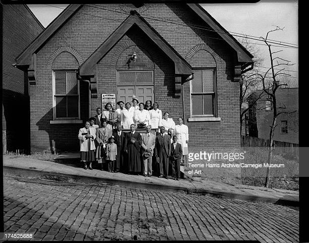 Elder W J Jerry with congregation in front of New Covenant United Holy Church Chauncey Street Hill District Pittsburgh Pennsylvania October November...