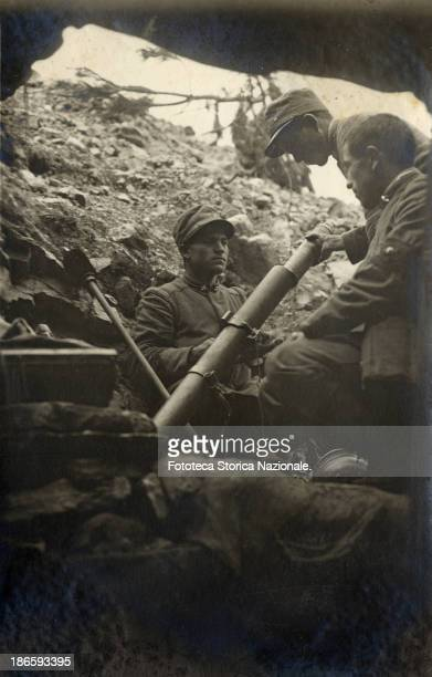 The Stokes mortar was a British trench mortar invented by Sir Wilfred Stokes in 1915 Into an Italian trench this infantryman was preparing a bomb...