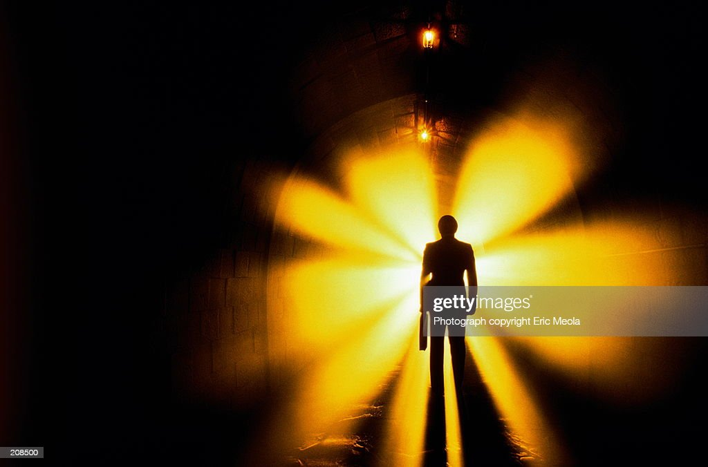 SILHOUETTE OF MAN IN TUNNEL WITH LIGHTS : Stock Photo