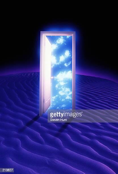 desert sand & door ajar with clouds - magic doors stock pictures, royalty-free photos & images